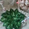 Detalle base de hojas soporte figura de tarta boda